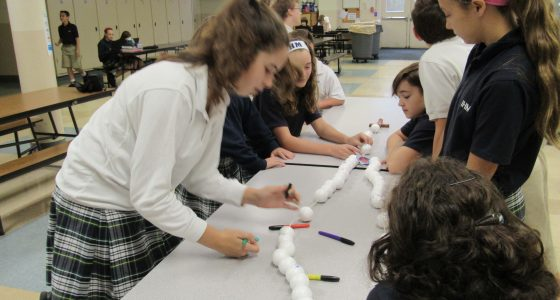 7th Grade religion classes work on class size rosaries